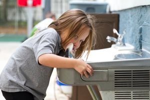 Summer Camp Student at Drinking Fountain