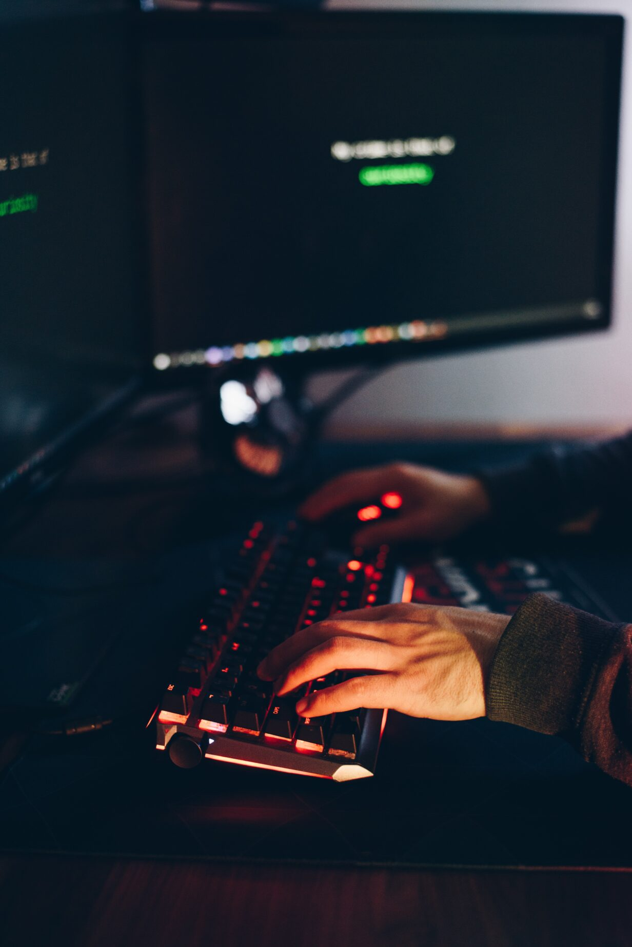 Picture of hands on a computer keyboard with a dark background