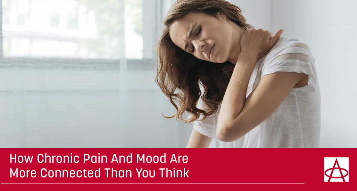 header image for blog a woman holds her shoulder with a pained expression on her face the caption says how chronic pain and mood are more connected than you think
