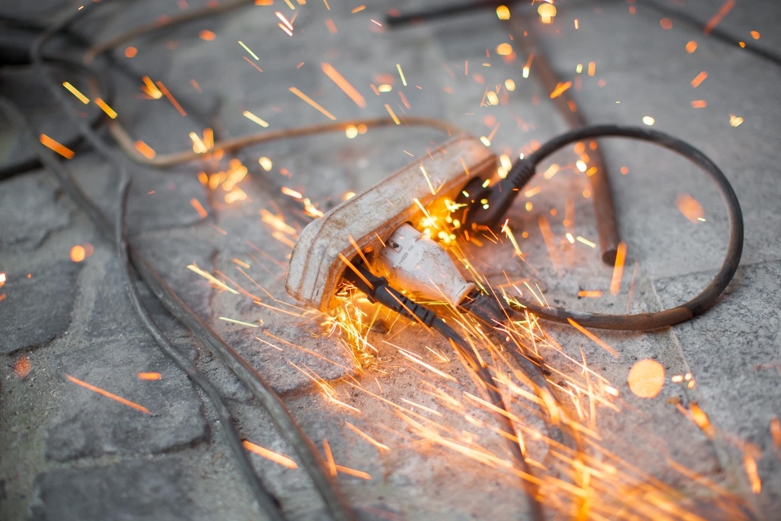 burning electrical outlet shorting, danger