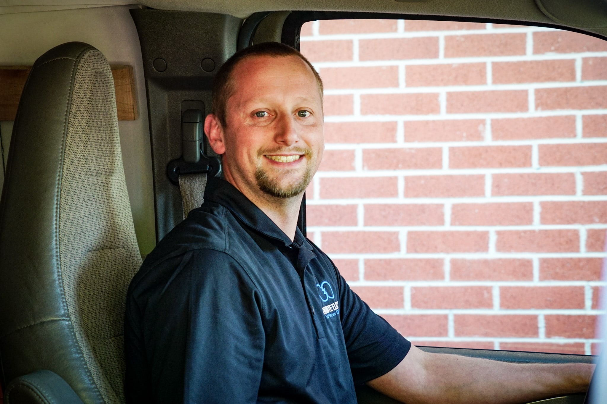 Josh from Infinite Electric driving a service van