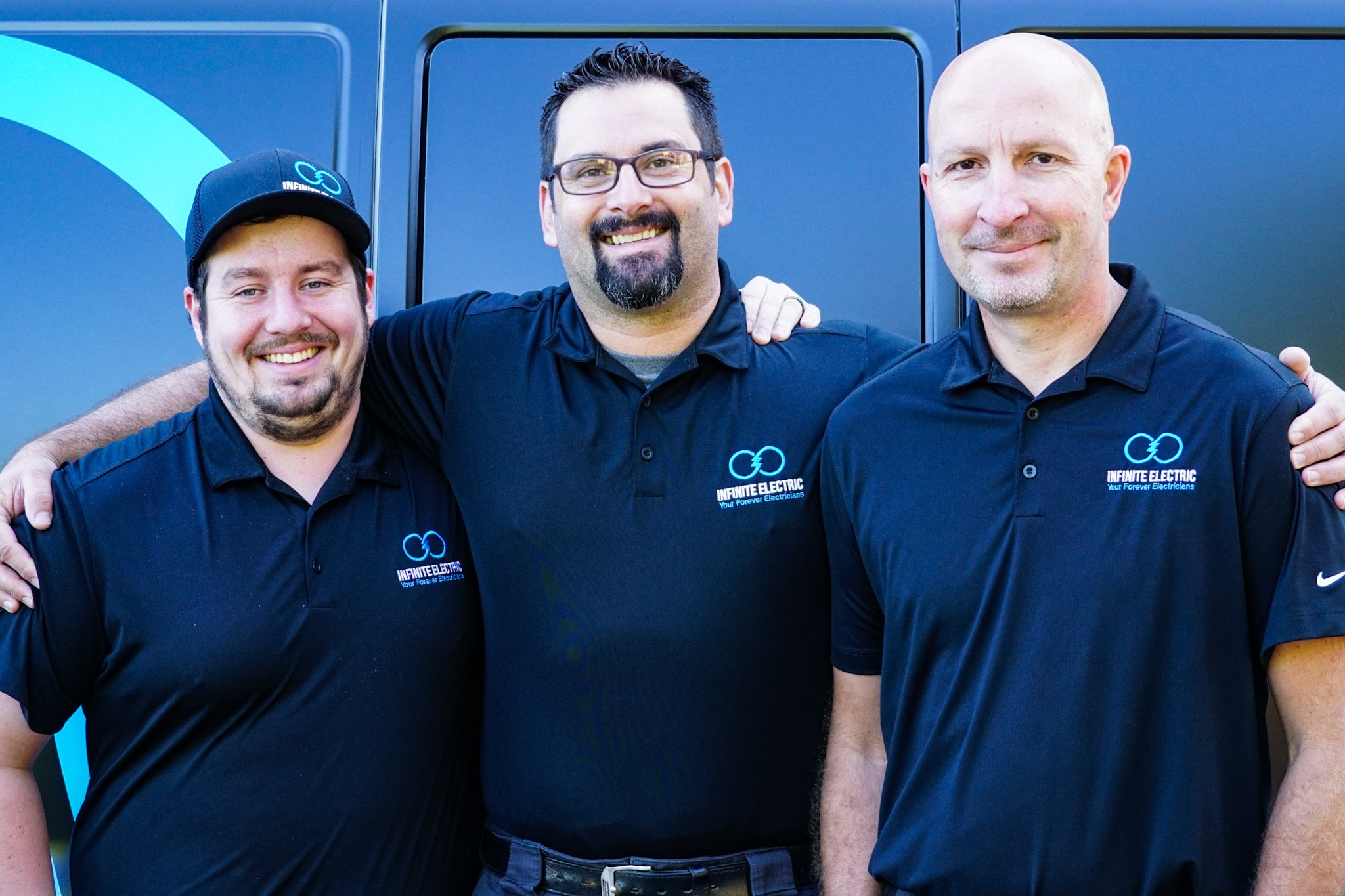 Infinite Electricians standing in front of their service van in Liberty Lake