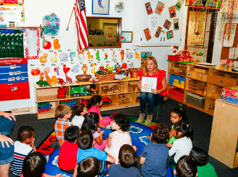 About Us - Jessica Capshaw reading to classroom