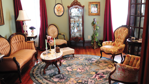 Julia Wood's home is ornately decorated with Victorian furniture, some of which Wood inherited from her family. The living room (above) is decorated to resemble how Wood remembers the room as a little girl.