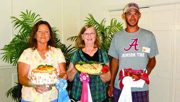 Beau Kendrick (third from left) placed third in the adult division of last year's Chilton County Peach Festival Cook-Off for his Smoky Peach Turnover. Kendrick is pictured with first-place winner Vivian Wallace (left) and second-place winner Peggy Green.
