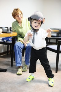 Zecharia Curtis, 5, will play the role of one of the rats in the production this year. Diana Hiott (above) helped with the designs for the masks.