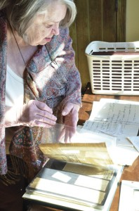 Mary Kate Weir looks through information about her lineage, which can be traced back to Martha Washington.