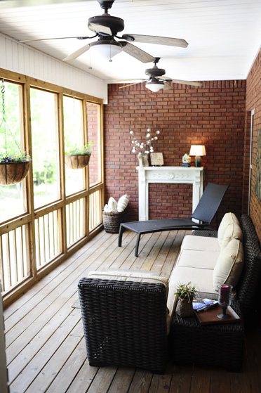 The back porch (above) is one of the family's favorite areas of their house. Overlooking the backyard, the porch is a comfortable gathering place for the family.