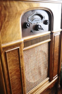 This 1930 Atwater Kent radio once belonged to Schiermann's great-grandfather. At right, he sits by another example of his many antique radios.