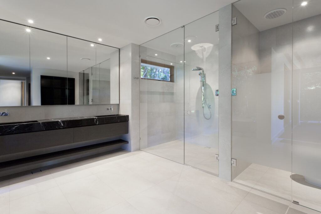 Custom Mirror in a bathroom next to a Shower Enclosure by Markham Glass & Mirror