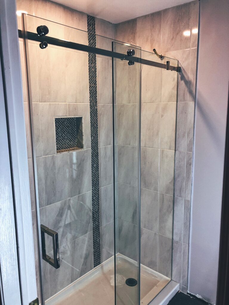 Sliding Shower Glass Doors in a Residential Bathroom by Markham Glass & Mirror
