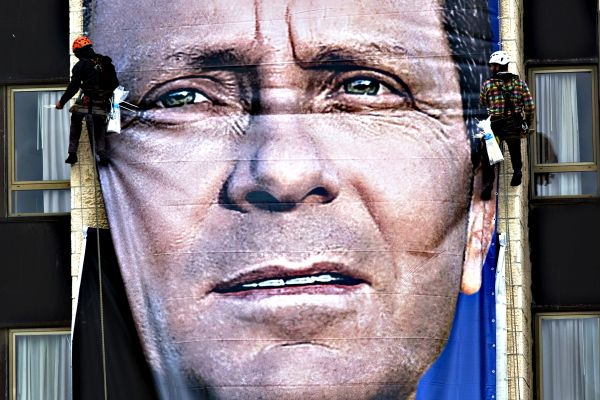 Isaac Herzog poster goes up in Jerusalem...epa04644269 Workers p