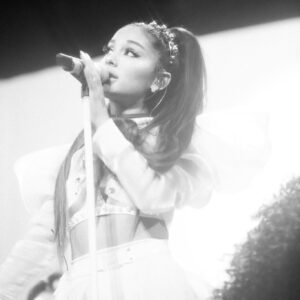 Ariana Grande signing during a performance