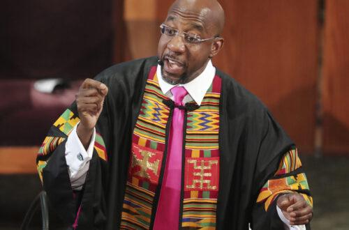 Senator Rev. Raphael Warnock giving a sermon at a local church