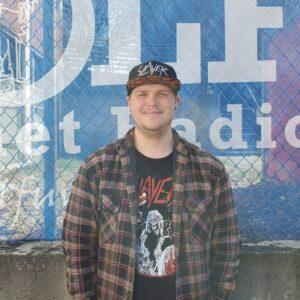 Dalton Browning of The WOLF Internet Radio looking at camera