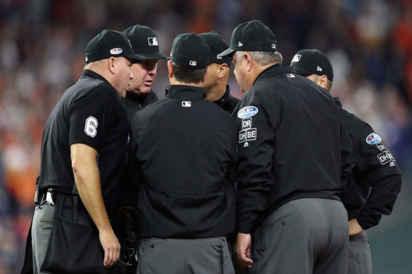 MLB Umpires huddled to discuss a play