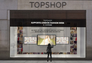Topshop's social curation interactive window for SS15