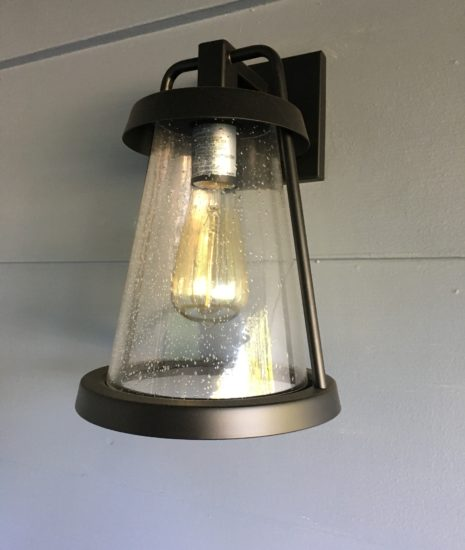 Black lantern with seeded glass and Edison bulb