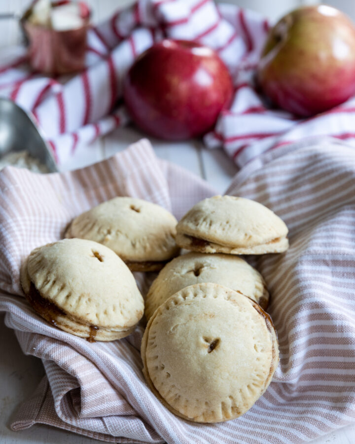 Apple Hand Pies placed in a pink towel
