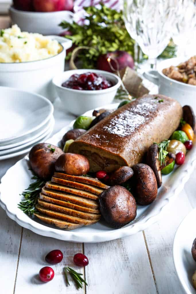 Holiday Roast served on a plate with Mushrooms, Mashed Potatoes, and Stuffing