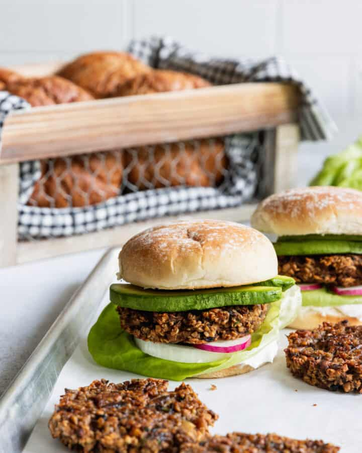 Mushroom Oat Burgers served with fresh burger buns and avocado