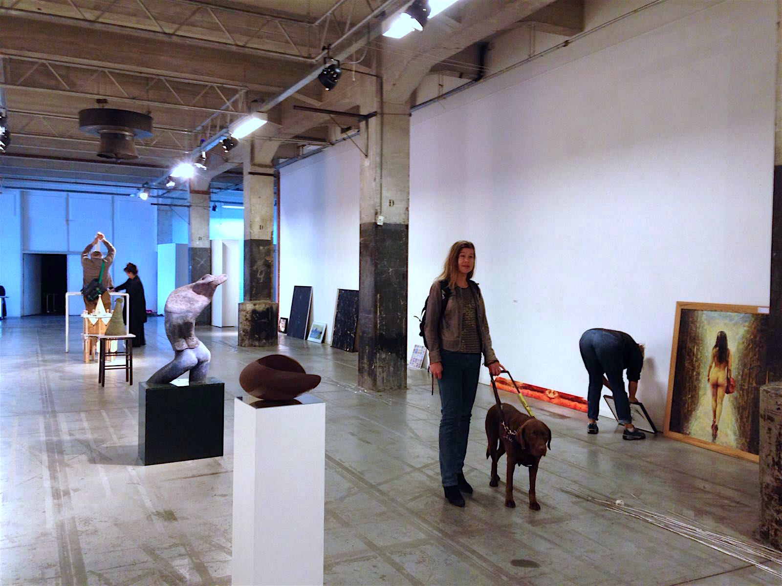 Photo shows Laura Meddens and her guide dog Nugget checking the preparations for the Open Ateliers Oost exhibition this Saturday and Sunday at the SBK Gallery in Amsterdam. Photo by Helen Pappa Hoitsma.