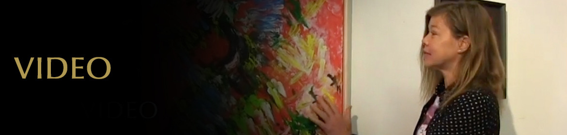 """Video Page Banner: Video still of Laura Meddens feeling the texture of her painting """"Tropical Splash"""" at her first public exhibition."""