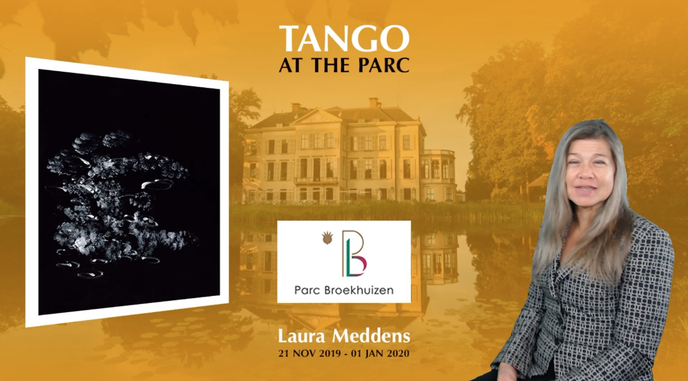 """Video frame shows Laura Meddens and her painting """"Tango"""" against a large photo background of Parc Broekhuizen in Leersum, for her exhibition from the 21st of November 2019 to the first of January, 2020."""