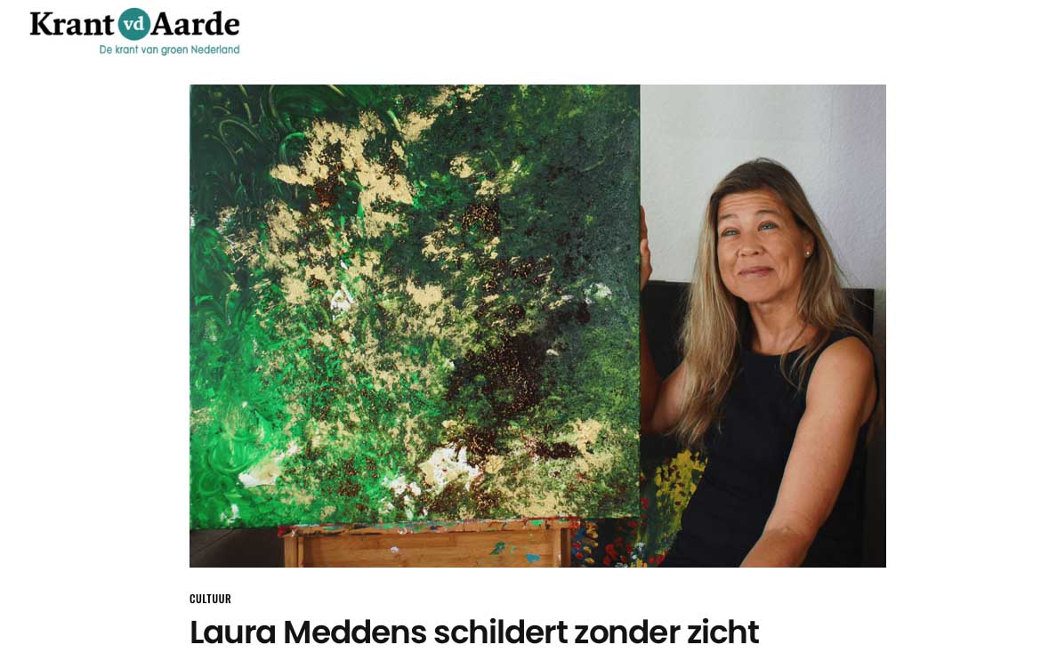 Cover page to profile of Laura Meddens in the Dutch language Newspaper Krant van der Aarde - Newspaper of the Earth. Laura sits beside one of her paintings.