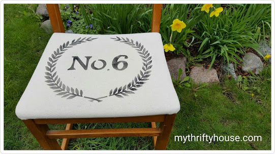 Salvaged desk chair covered with drop cloth and stenciled with paint