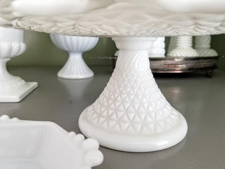 displaying milk glass cake plate