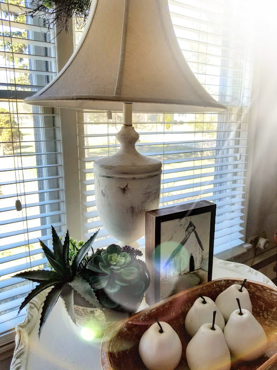 This DIY distressed farmhouse lamp is the perfect piece on my table.