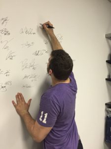 Brett McMakin, a member of SSI's NFL Combine Class and now a member of the Atlanta Falcons, signs the Pro Wall.