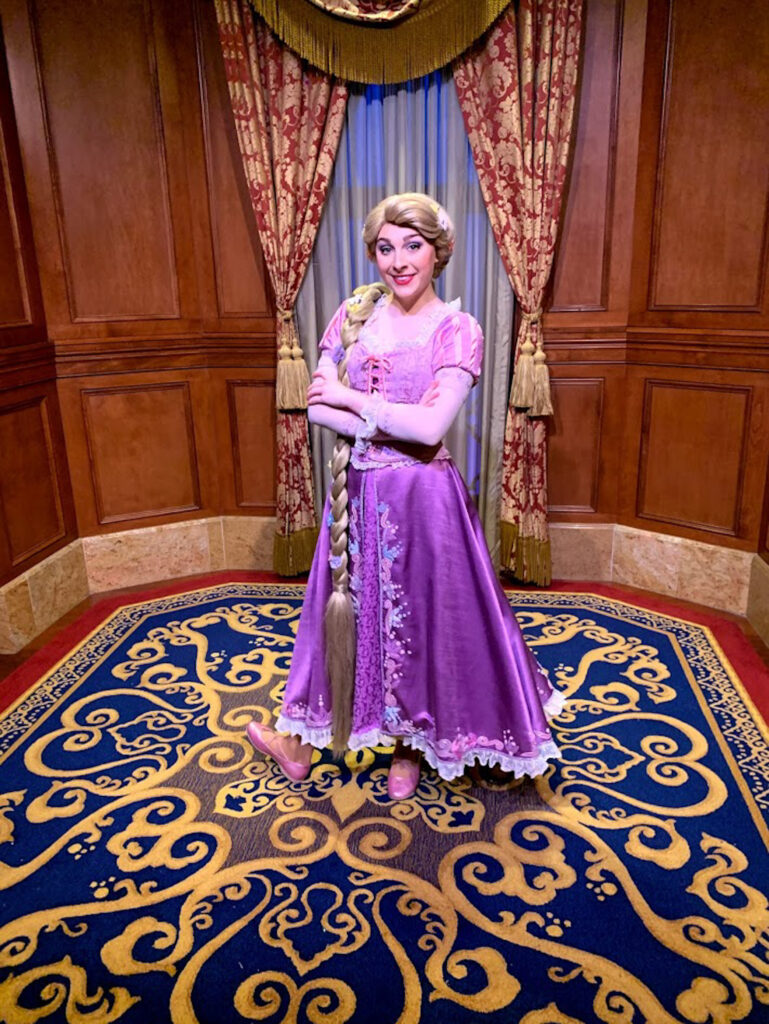 Rapunzel Princess Meet and Greet at Disney World, dressed in purple and sporting her classic long blonde braid