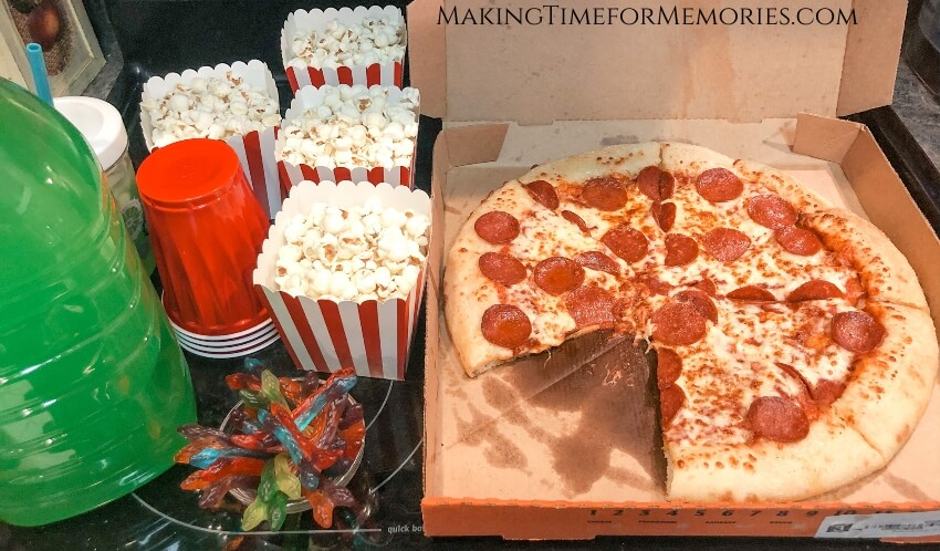 Toy Story Movie Night food and snacks - pepperoni pizza, popcorn, gummy snakes and green punch