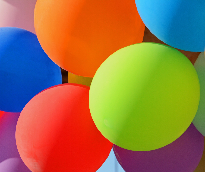 group of colorful balloons - red, green, orange, blue, pink, purple