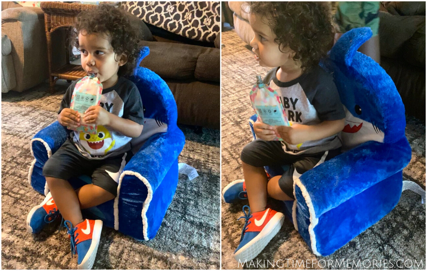 toddler boy sitting in his blue plush shark chair