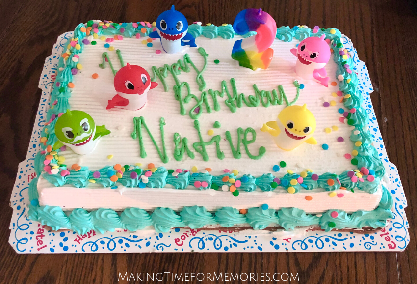 ice cream cake with mini Baby Shark figures as cake toppers