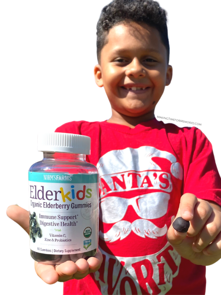 boy holding Norm's Farms ElderKids Organic Elderberry Gummies, which help boost the immune system