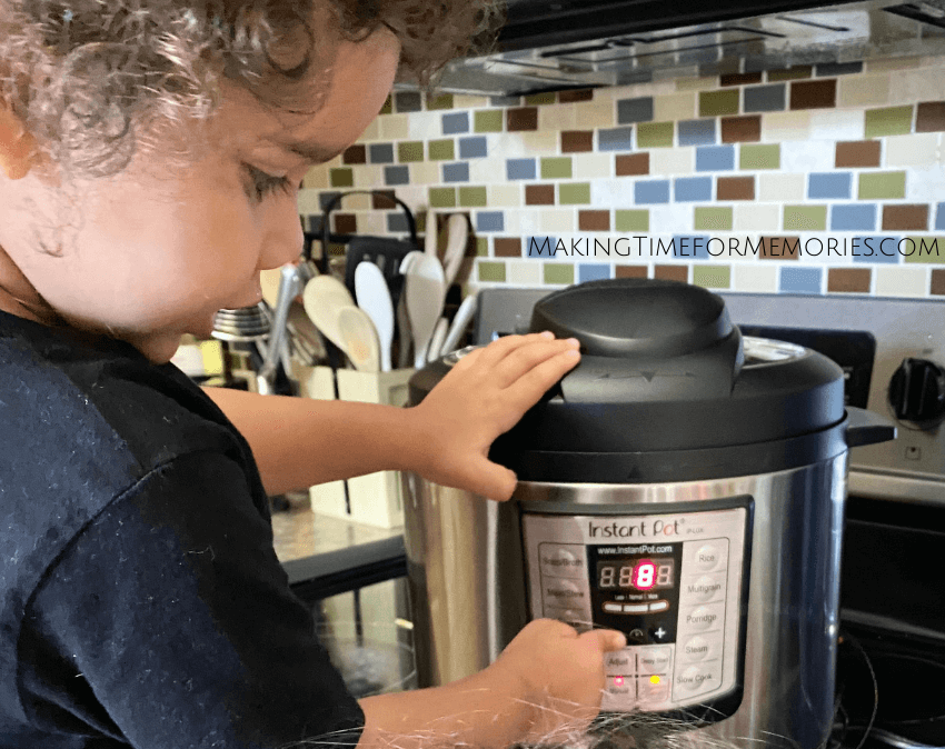 little boy inputting cooking directions on the Instant Pot