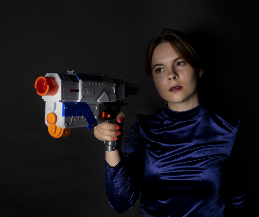 woman ready for a NERF gun battle