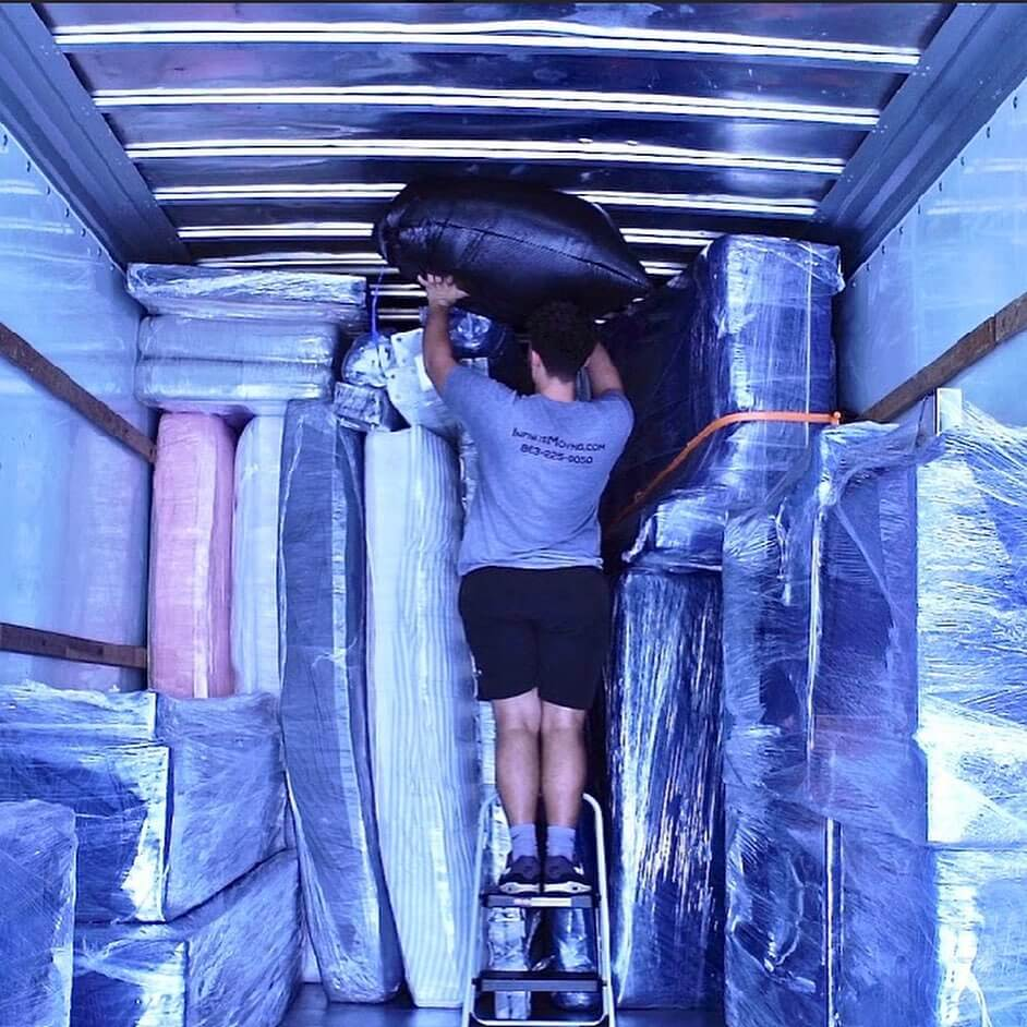 Infinite Moving packing a moving truck