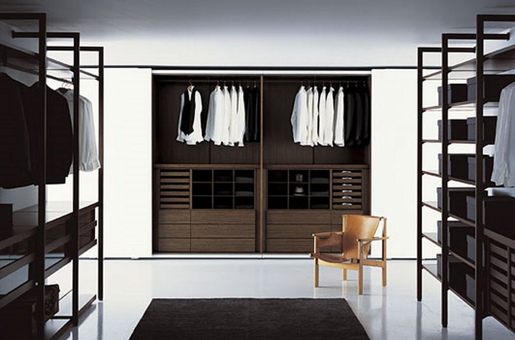 Modern-Interior-Design-with-a-room-with-racks-for-hanging-clothes-and-drawers-and-a-chair-and-a-white-tiled-floor-Modern-Closet-Organizer-Ideas-
