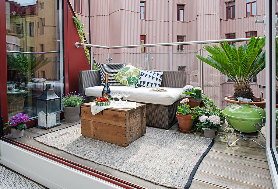 Urban-Apartment-with-Terrrace-charming-eclectic-terrace-with-outdoor-lounge-and-potted-plants