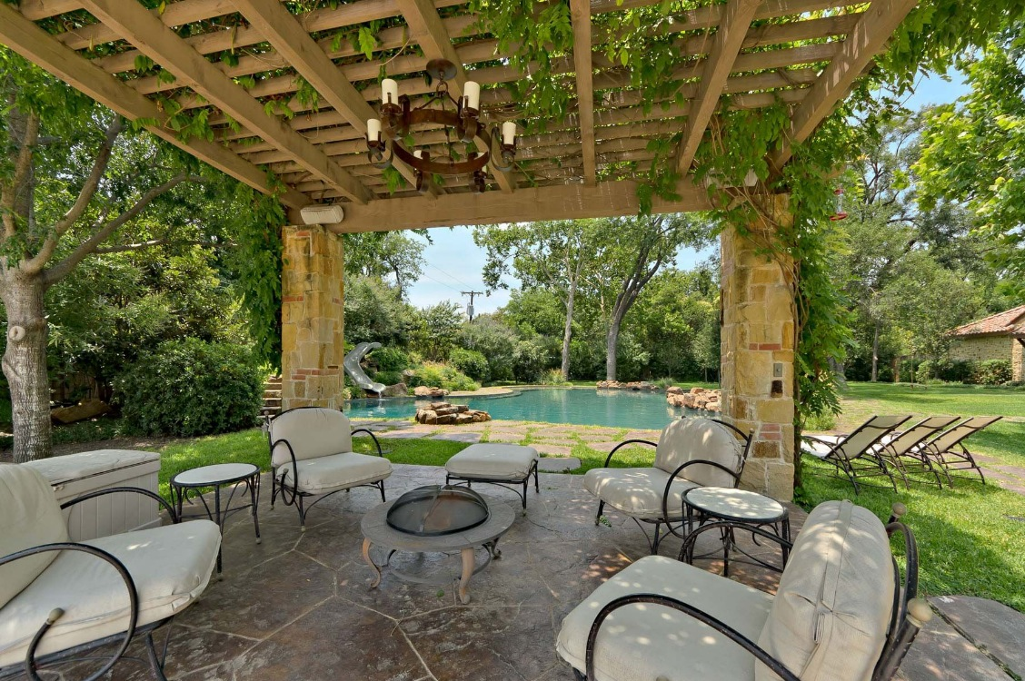 large-wooden-pergola-canopy-with-decorative-ivy-plants-plus-cream-outdoor-living-space-seating-area