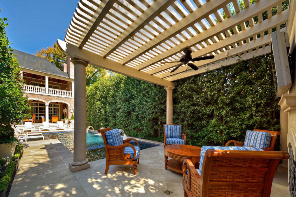 Luxurious-Outdoor-Living-Space-Idea-With-Round-Brown-Table-Brown-Blue-Chairs-And-Black-Fan-Breathtaking-Outdoor-Living-Space-Ideas-1220x812