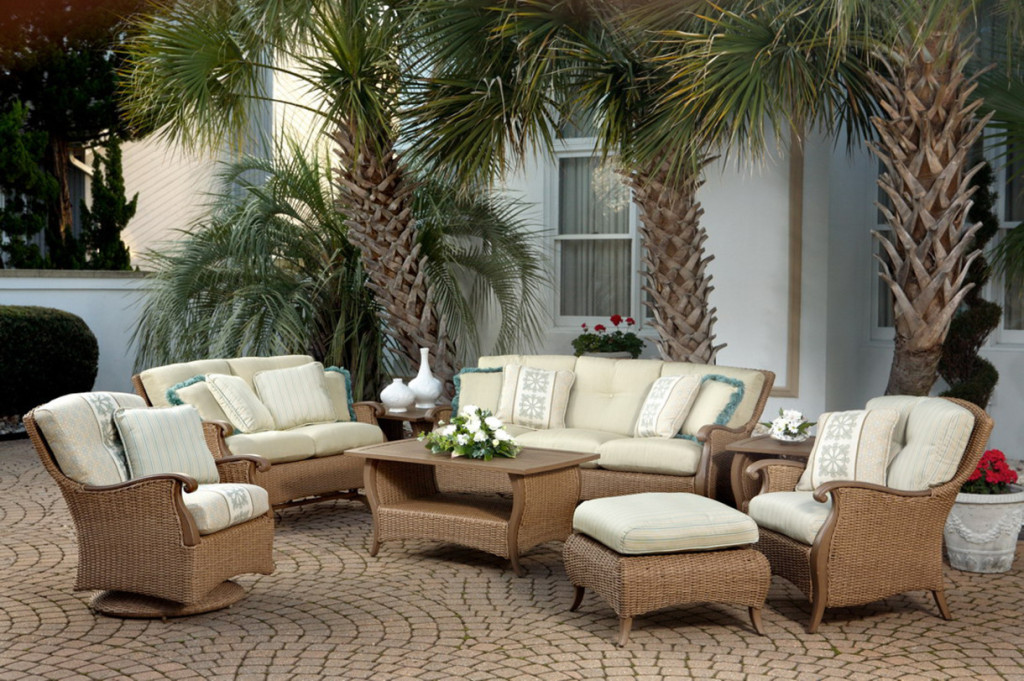 Romantic-Modern-Outdoor-Furniture-Design-Idea-With-Brown-Wicker-Coffee-Table-With-White-Flowers-And-Brown-Wicker-Sofas-With-White-Seat-Cushions-Luxury-Modern-Outdoor-Furniture-Design-Ideas-1220x811