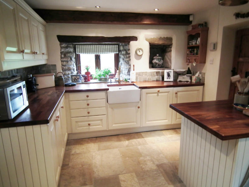 photo of farmhouse kitchen beige brown kitchen