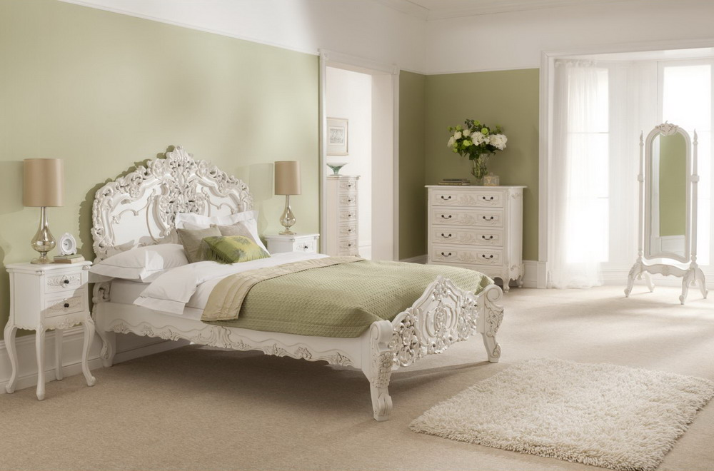 White-Furniture-Sets-In-A-French-Bedroom-Design-With-Area-Rug-And-Flower-Decoration