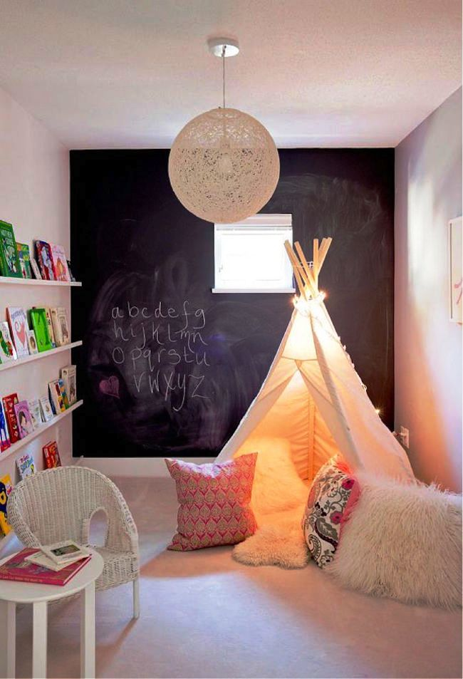 Cozy-white-teepee-with-lots-of-comfy-pillows